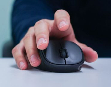 man-hand-using-mouse-cursor-scrolling-web-page-working-computer-1024×558